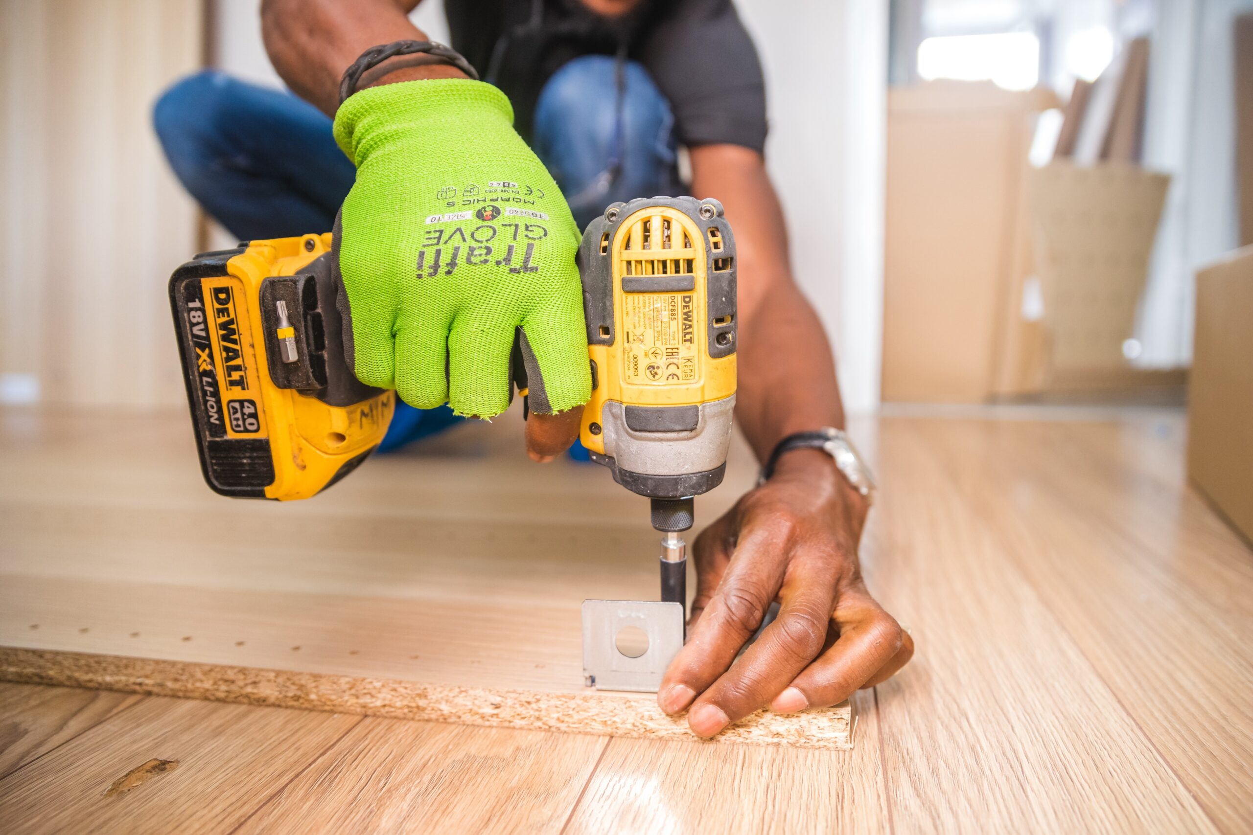 http://caymanitemaintenance.com/wp-content/uploads/2020/07/person-using-dewalt-cordless-impact-driver-on-brown-board-1249611-scaled.jpg